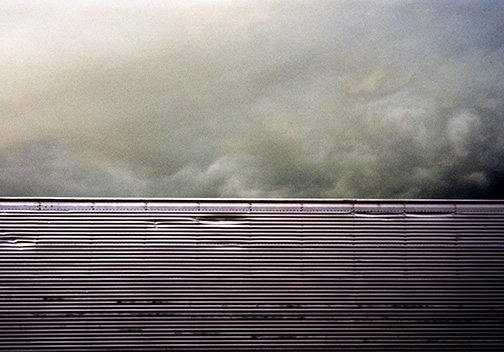 Corrugated metal and clouds